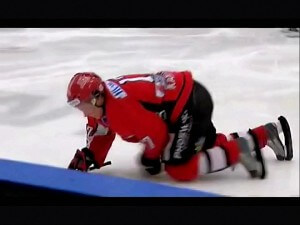 Swedish hockey players jumps on the ice without removing his skate guards