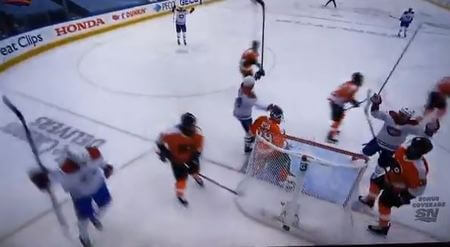 Canadiens' Suzuki taps Hart on the head after Armia's goal ...