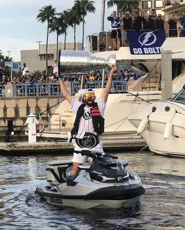 Alex Killorn hoists the Stanley Cup from his jet ski during the Tampa Bay Lightning Stanley Cup Boat Parade. Epic Scenes from the Tampa Bay Lightning's Legendary Stanley Cup Celebration